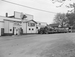William's Auto Parts and Hotpoint Appliances Store, Broadway, Va. Side view with trucks.