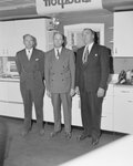 Three men standing in front of a showcase of Hotpoint Appliances inside of William's Store. Broadway, Va.