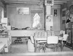 Basye Community Store, Inside view picturing a card table, jukebox, and loaves of bread.