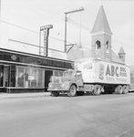 Walter's Restaurant, outside view, with an ABC Dog Food truck driving in front. by William Garber