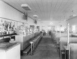 Inside of Walter's Restaurant, with both the counter and opposite booth tables pictured. by William Garber