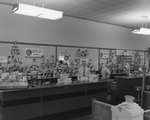 Inside of Walter's Restaurant, with an alternate view of a man and applesauce display behind the counter. by William Garber