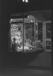The front window of Hodgin's Store (electronics and sporting goods) in Woodstock, Va. Window advertises National Baseball Week, April 3-10. by William Garber