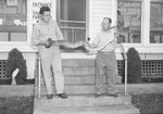 Two men holding a large snake outside the front door of Stroop's Snake Farm. Bowmans Crossing, Va. by William Garber