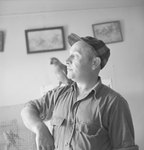 Man with a bird on his shoulder inside of Stroop's Snake Farm. Bowmans Crossing, Va. by William Garber