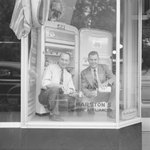 Marston's Home Appliance Store, view of two men pouring drinks in the window display. by William Garber