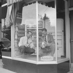 Marston's Home Appliance Store, view of two men in the window display. by William Garber