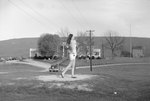 A woman swinging a golf club at the Shenvalee Hotel and Golf Resort, New Market, Va. by William Garber
