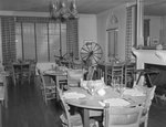 Inside the Lee-Jackson Hotel, view of the dining area, with a spinning wheel in the background. New Market, Va. by William Garber