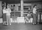 Inside of the Shenandoah Alum Springs Hotel, a group of people socializing and dancing. Orkney Springs, Va. by William Garber