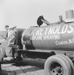 A chemical storage truck for Jack Reynold's airplane spraying service by William Garber