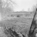Diagonal view of a covered bridge by William Garber