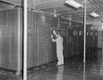 A man working in a large storage or freezer room