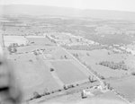 Distant view of the Shenandoah County Fairgrounds in Woodstock, Va by William Garber