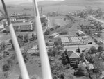 View of Maury Hall, Varner House, Jackson Hall, Harrison Hall, Logan Hall, and Converse Hall and Bluestone Drive of James Madison University, with parts of the plane blocking the view. Harrisonburg, Va. by William Garber