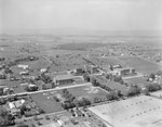 A number of large buildings, probably of the Eastern Mennonite University campus. Harrisonburg, Va. by William Garber