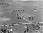 Houses, fields, farmland, and drive-in movie theatre by William Garber