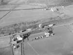 Close up view of a collection of farm buildings by William Garber