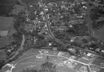 An expansive view of a major highway intersecting a residential area by William Garber