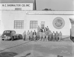 Group of men posing in front of Showalter Mill, Broadway, Va.