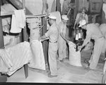 Group of men working at Mt. Jackson Mill. by William Garber