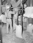 Man working inside of Mt. Jackson Mill. by William Garber