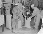 Group of men working at Mt. Jackson Mill. Mt. Jackson, Va. by William Garber