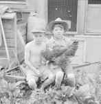 Two small boys holding a chicken at the Mt. Jackson Mill. Mt. Jackson, Va.