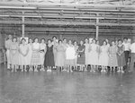Group of women posing inside of New Market Manufacturing (possibly a sewing/clothing factory). New Market, Va.