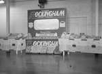 "A ""Genuine Rockingham Virginia Poultry"" display, set up for a fair or other kind of show/presentation. Sponsored by Rockingham Plants in Broadway, Va., and advertising ""Ready to Cook Virginia Fryer"". by William Garber"