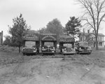 Four Robinson Produce Trucks, each of a different size by William Garber