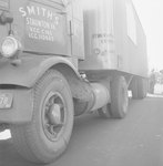 "Company truck for ""Smith's,"" View of the side, from the ground"
