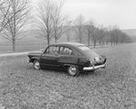 Private automobile, parked in a field