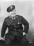 Portrait of police officer Charley Grabill, smiling or laughing by William Garber