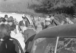 A number of Mt. Jackson police officers and other men standing next to a car with a cracked windshield by William Garber