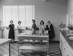 New Market Fire Department open house: view of a group of women leaning against the counter in the kitchen