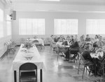 New Market Fire Department open house: large group of men, women, and children dining together in a large room with a  buffet table at the head