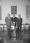 Broadway Volunteer Fire Department, possibly an open house; three men in suits standing behind a podium