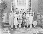 A group of young men and women standing in front of Timberville (High) School by William Garber
