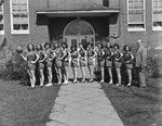 Timberville (High) School, women's basketball team, lined up in front of the school with their coach by William Garber