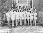Timberville (High) School, women's softball team posing with their coach in front of the school by William Garber