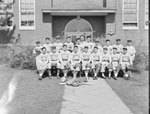Timberville (High) School, men's baseball team posing in front of the school