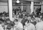 Broadway (High) School, large group of young men and women eating in the cafeteria. by William Garber