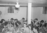 Broadway (High) School, group of young men and women eating in the cafeteria.