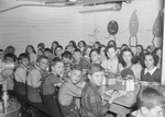 Broadway School, large group of boys and girls eating in the cafeteria.