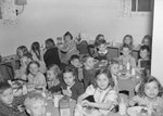 Broadway School, group of young boys and girls eating in the cafeteria.