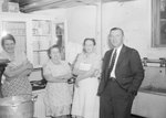 Broadway School, three cafeteria workers standing next to a man in a suit.