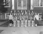 Broadway (High) School, women's basketball team posing in front of the school.