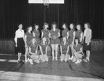 Broadway (High) School, women's basketball team posing in the gym.