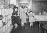 Broadway School, three young children in Halloween costumes.
